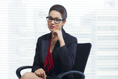 welldressed: Portrait of confident businesswoman sitting in office