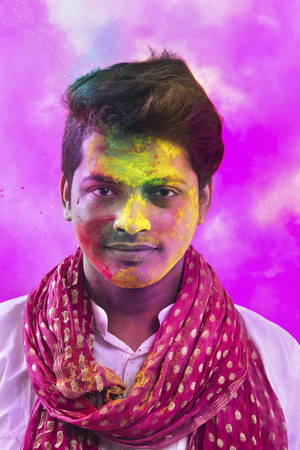 kurta: Portrait Of Young Man With Paint On Face During Holi Stock Photo
