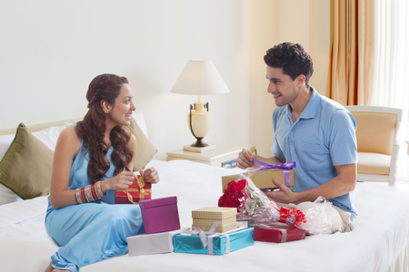 Couple opening gift boxes