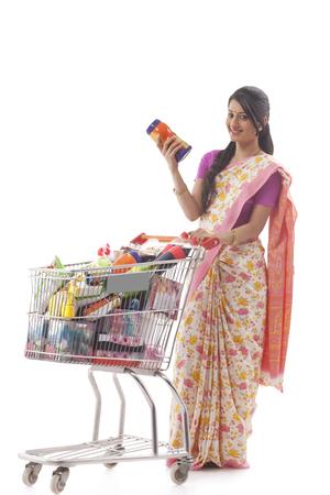 Young woman carrying a shopping cart