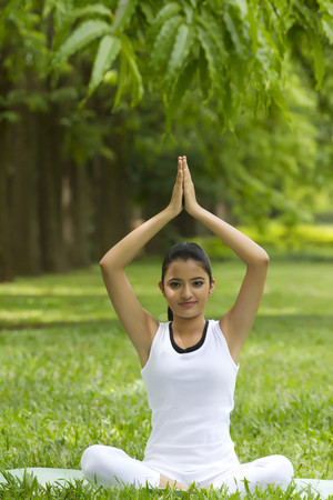 Portrait of young woman in yoga position