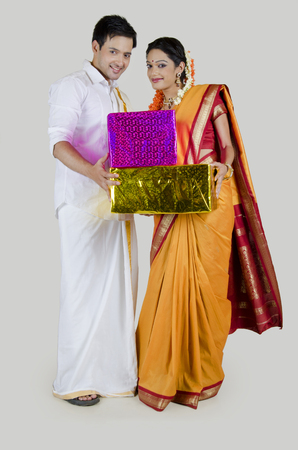gajra: Portrait of South Indian couple with gifts