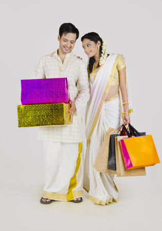 gajra: South Indian couple with shopping bags and gifts