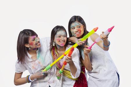Three women playing holi