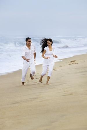 joyfulness: Couple enjoying themselves at a beach
