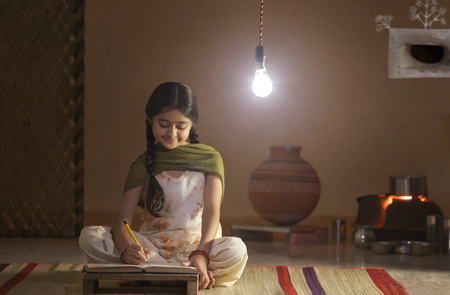 front house: Rural girl studying at night