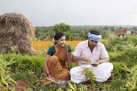 karnataka: Rural man having lunch as his wife looks on
