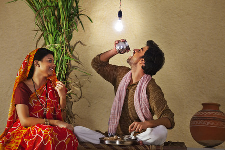 sutra: Rural man drinking water as wife watches