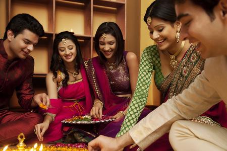 Friends making a rangoli