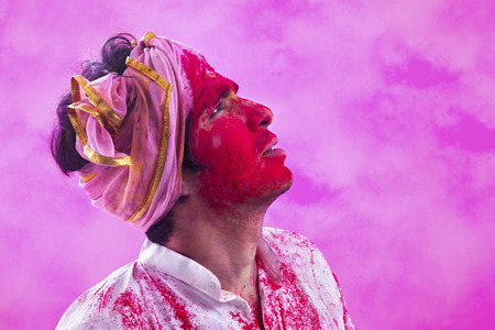 Indian Young man Celebrating the Holi Festival of Colors Stock Photo