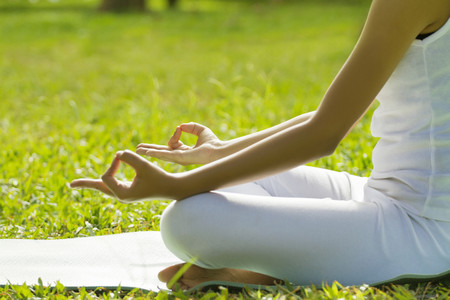 legged: Young woman sitting in lotus position Stock Photo