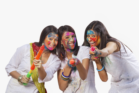 toothy: Portrait of three women playing holi Stock Photo