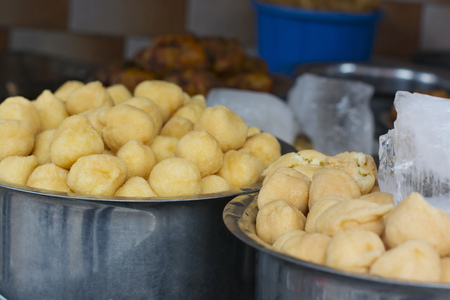 Close-up of vadas in containers at stall Stock Photo