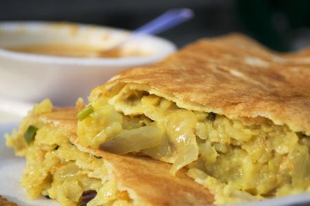 Close up of masala dosa with masala filling