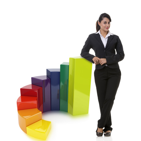 welldressed: Portrait of confident businesswoman with multi colored bar graph representing growth over white background Stock Photo