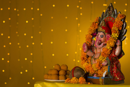 Ganesh idol and laddus Stock Photo