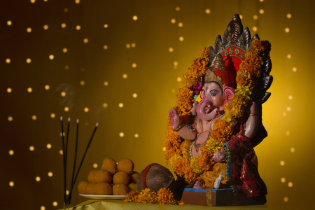 Ganesh idol and laddus Stock Photo