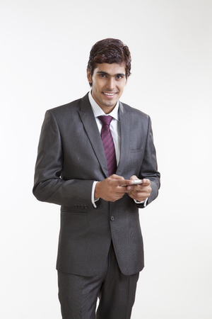 Portrait of business executive with a mobile phone