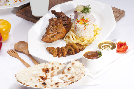 red onions: Tandoori chicken,rice,potatoes and naan