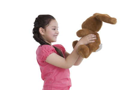 Little girl holding a toy rabbit