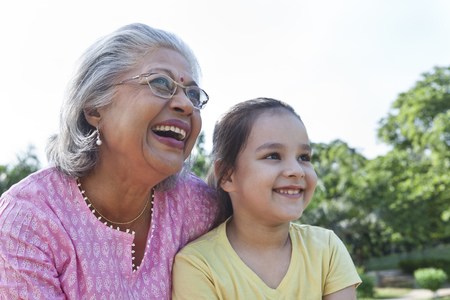 toothy: Grandmother and granddaughter enjoying Stock Photo