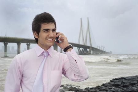 maharashtra: Businessman talking on a mobile phone