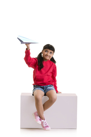 aspirational: Girl playing with paper plane