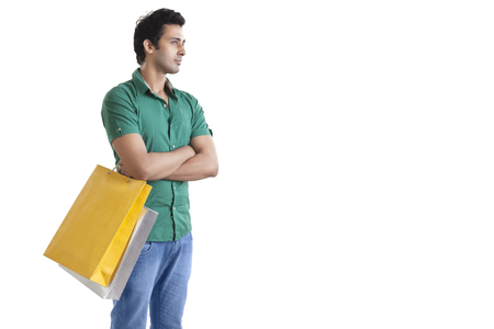 Young man with a shopping bag thinking