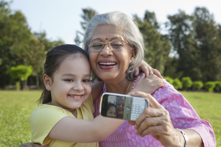 toothy: Grandmother and granddaughter taking a self portrait