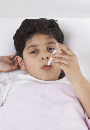 one sheet: Little boy with thermometer in his mouth