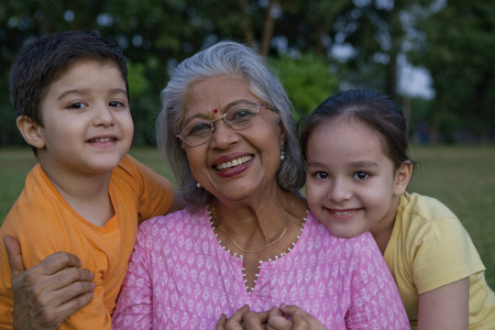toothy: Portrait of grandmother with grandchildren Stock Photo