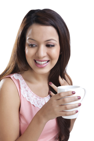 toothy: Young woman with a mug smiling