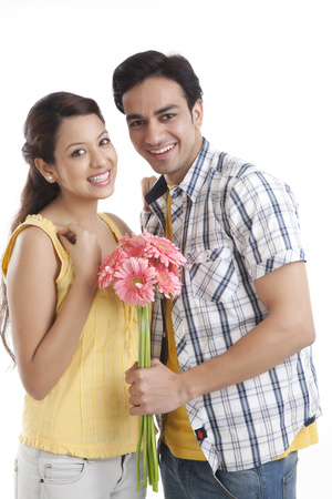toothy: Portrait of young couple with flowers