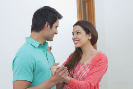 off shoulder: Young couple with keys of new house