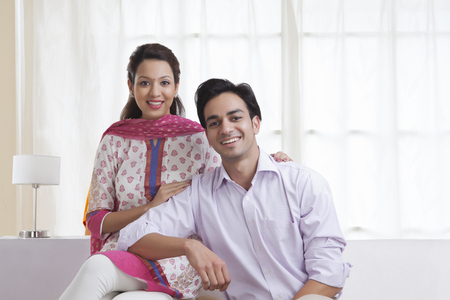 kameez: Portrait of a married couple smiling