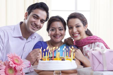 kameez: Portrait of family with a birthday cake