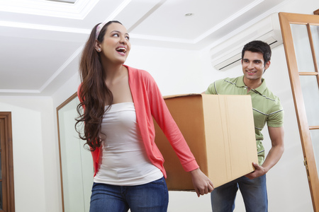 thrilled: Young man and young woman looking at lay out of house