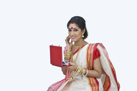Bengali woman with a jewelery box