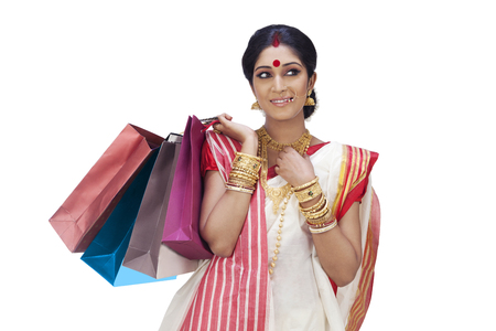 25 30: Bengali woman with shopping bags