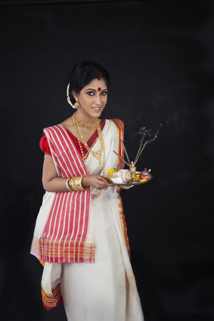 Portrait of Bengali woman with puja thali