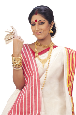kolkata: Portrait of Bengali woman holding currency notes