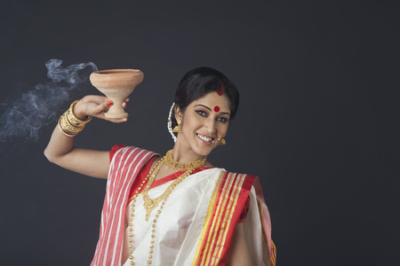 25 30: Portrait of Bengali woman with dhunuchi Stock Photo