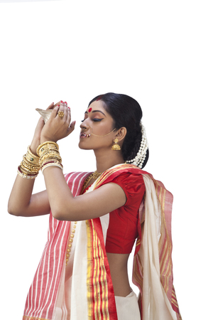Bengali woman holding a conch shell Stock Photo
