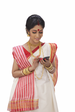 Bengali woman reading an sms on a mobile phone