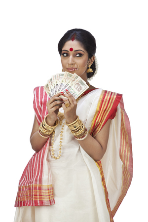 Bengali woman holding currency notes Stock Photo