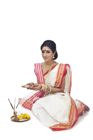 Portrait of Bengali woman holding a diya Stock Photo
