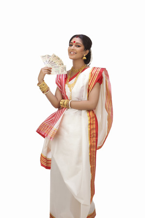 Portrait of Bengali woman holding currency notes