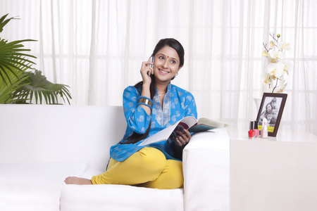 Young WOMEN talking on cell phone Stock Photo