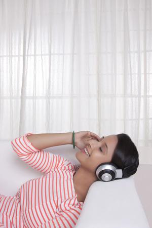 'eyes shut: Young WOMEN listening to music