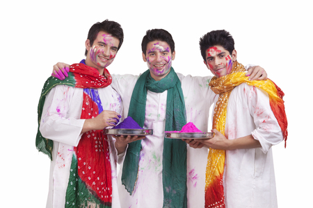kurta: Portrait of friends with holi colours Stock Photo